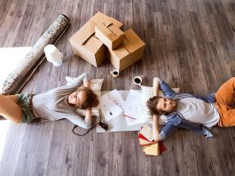 Young couple moving in new house, drinking coffee.